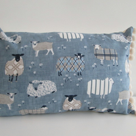 Blue  Sheep Cushion with cream Pom Poms