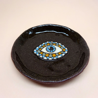 Small ceramic dish with eye