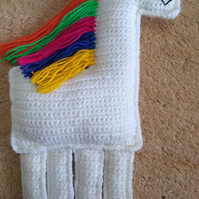 Ragdoll style crochet unicorn with rainbow main