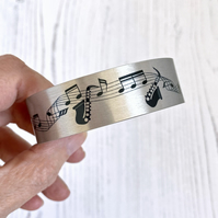 Musical instrument cuff bracelet in brushed aluminium with music notes B20