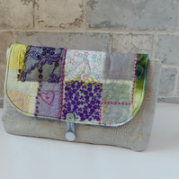 Catmint clutch bag in silver, purple and mint green