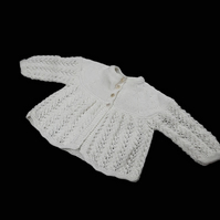 Soft cream baby cardigan with pretty lacy detail hand knitted lightweight yarn
