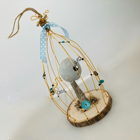 Wire bird cage with ceramic sculpture, fantasy art