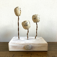 Ceramic sculptures on wire, wood base, home decor