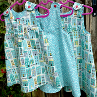 Homes and Hearts Turquoise Reversible Dress - 2 years