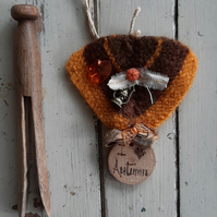 Knitted brooch medal