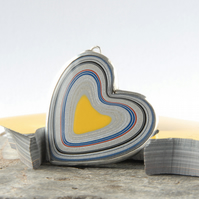 Super sparkly heart shaped fordite pendant