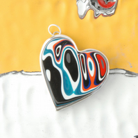 Heart shaped fordite pendant (Black and orange)