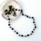 Onyx and black pearl necklace