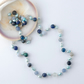Blue gemstones and pearl necklace