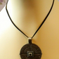 Pendant on black suede cord.