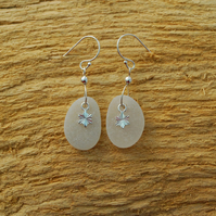 White sea glass earrings with silver stars