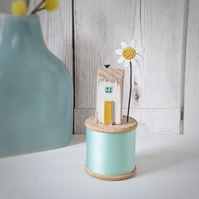 Wooden House on a Vintage Bobbin with a Clay Daisy