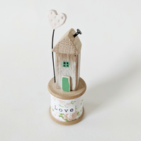 Wooden House on a Vintage Floral Bobbin with Clay Heart 'Love'