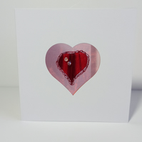 Hand embroidered heart with swarovski crystal bead embellishment.