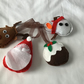 Set of four felt tree decorations