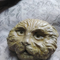 Cat with ears back carving