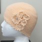 Peaches and Cream! Crocheted Cloche Style Hat with Floral Detailing.
