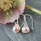 Long silver and pink pearl earrings