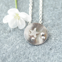 Dark silver domed star necklace