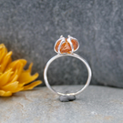 Silver and amber claw ring