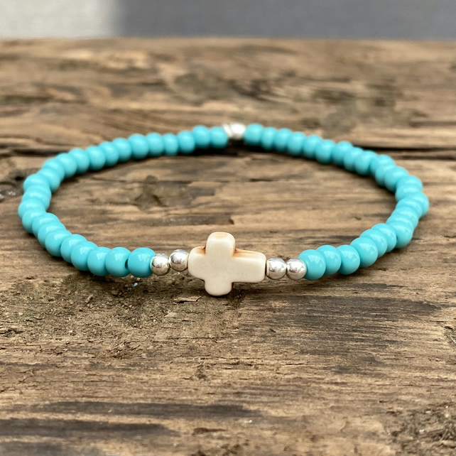 Cream howlite cross and turquoise seed bead bracelet