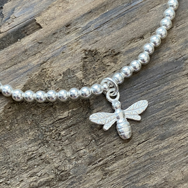 Sterling silver bead bracelet with honey bee charm. Stretch bracelet.