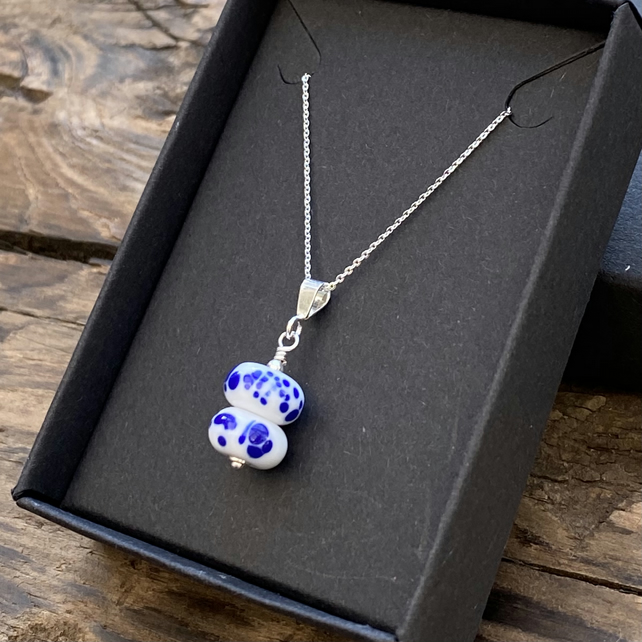 Mini lampwork pendant on sterling silver necklace. White & blue.