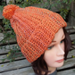 Crochet Rib Effect bobble hat in orange mottly yarn