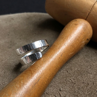Sterling silver adjustable wrap ring with hammered detail.