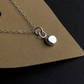 Recycled silver pendant with hammered surface on sterling silver chain.