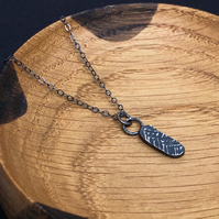 Oxidised recycled silver pendant with hammered texture.