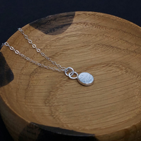 Hammered sterling silver pendant on sterling silver chain, recycled silver.