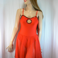 Red camisole dress with chiffon skirt and sequin trim