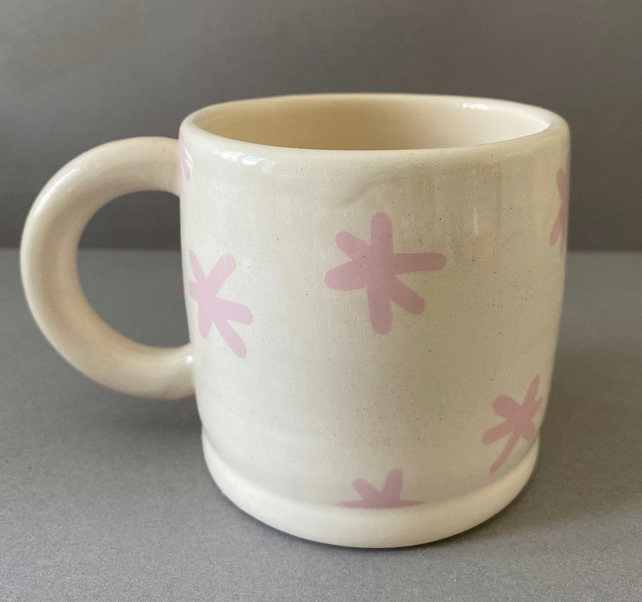 Pink abstract shape ceramic cup.