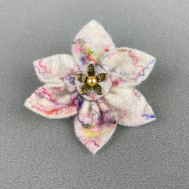 White felt flower brooch with coloured silk highlights