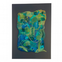 Wet felted and embroidered abstract textured wall art in green and blue