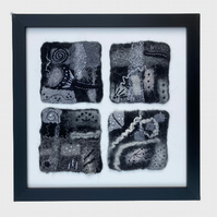 Monochrome felted abstract picture, with four panels, framed
