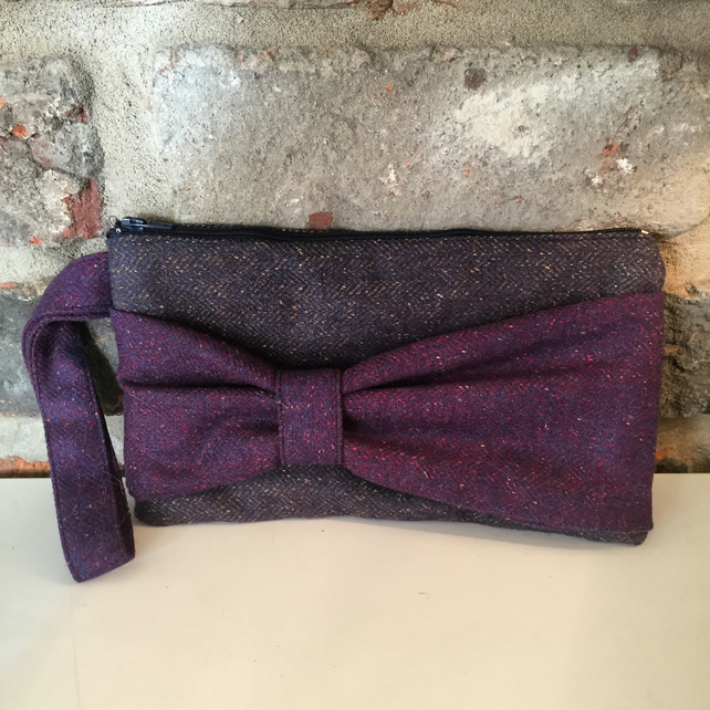 Wool zip top clutch bag with bow detail to the front