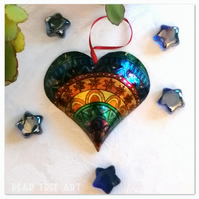 Rainbow embossed metal heart decoration. Handmade.