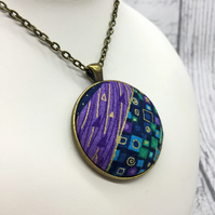 Geometric squares and dashes fabric button pendant in purples, blues and jades