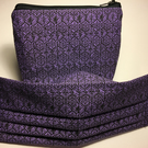 Purple black geometric pattern pleated face covering with zipper purse