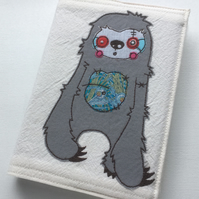 applique freehand embroidered zombie sloth A6 notebook