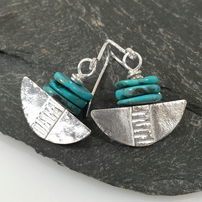 Silver and turquoise tribal blade earrings.