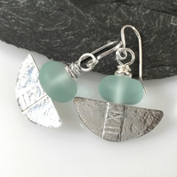Silver and aqua glass tribal blade earrings.