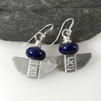 Silver and lapis lazuli tribal blade earrings.