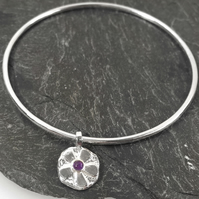 Sterling silver bangle with amethyst set flower charm