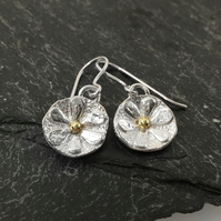 Small sterling silver flower earrings with gold centres
