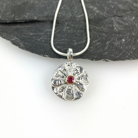 Silver and 18ct gold ruby Bloom pendant on chain