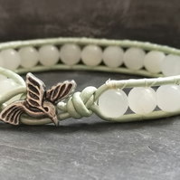 Pale green leather bracelet with white jade beads and hummingbird button